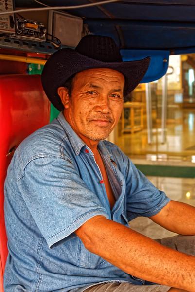 <i>Tuk-tuk</i> driver, Nakhon Phanom, northeast Thailand