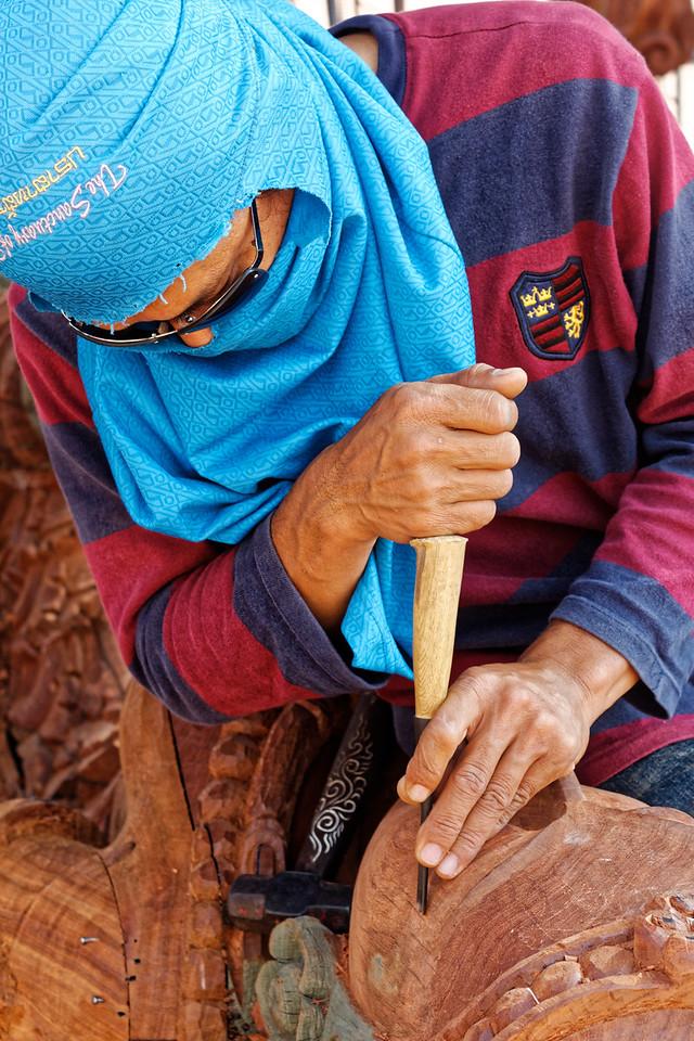 Carving a life-size wooden head at Prasat Sutja Tum, Pattaya