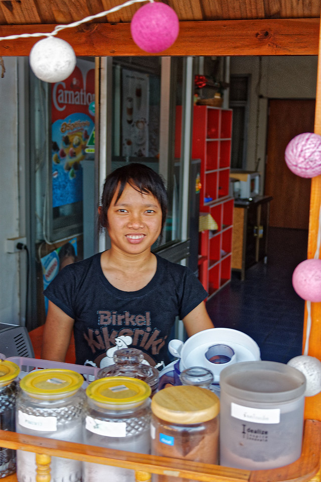 Proprietor of a shophouse coffee-and-beverage stand in Nakhon Phanom, northeast Thailand