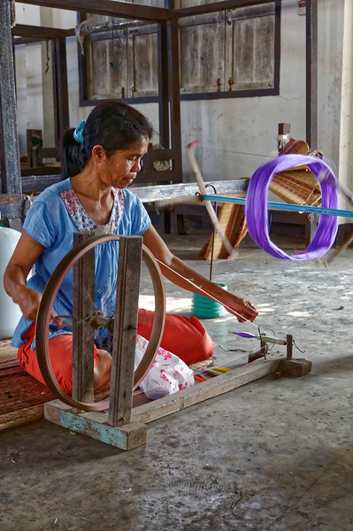 Silk spinner in the village of Bung Boon, Isaan