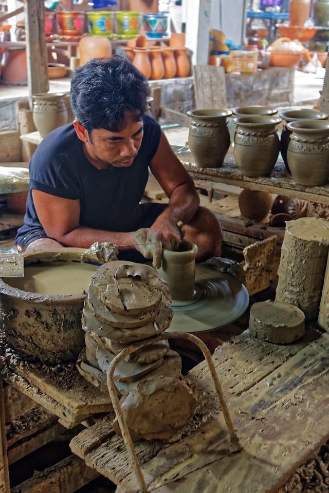 Ceramist at his wheel on Koh Kret, a small island in the Chao Phraya River near Bangkok