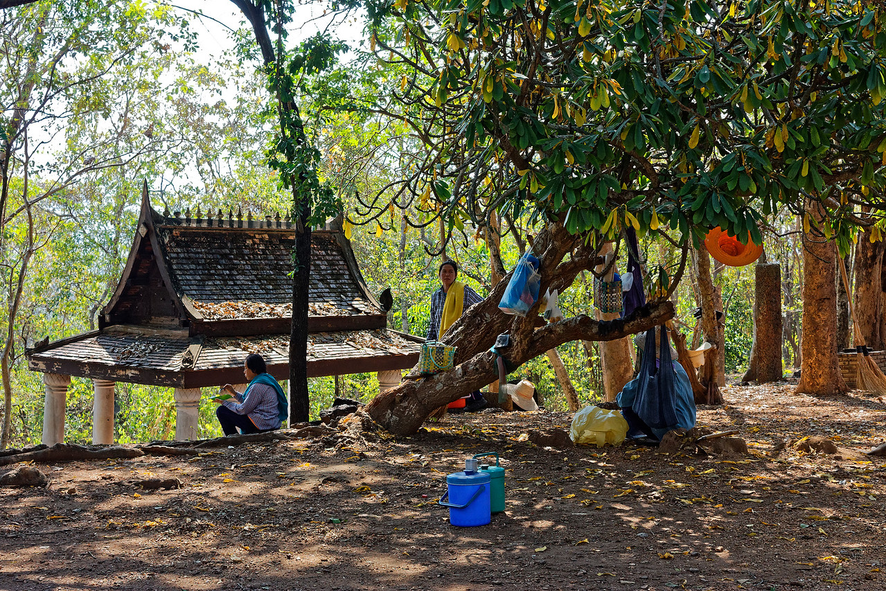 Workers taking a lunch break near the ruins of Wat Khao Suwankhiri, a spot that enjoys a sweeping view of the countryside from high above Si Satchanalai, central Thailand