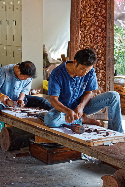 Wood carvers at Muang Boran, the Ancient City, in Samut Prakhan