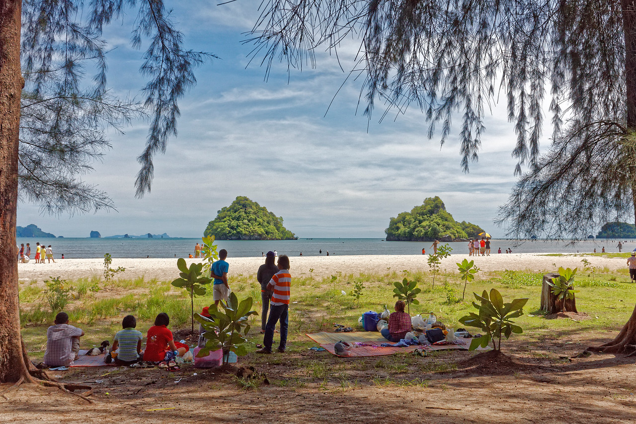 Beachgoers enjoying Nopparat Thara Beach, which abuts the Phi Phi–Hat Nopparat Thara Marine National Park in the Andaman Sea off Thailand's southern peninsula