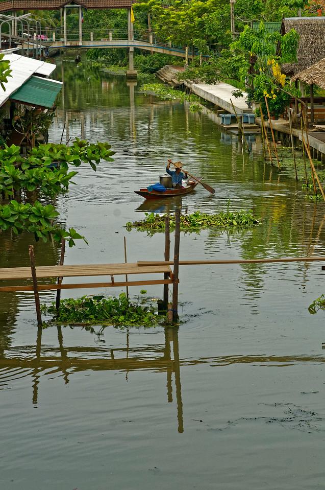 This very precarious-looking footbridge spans the canal at Tha Kha.
