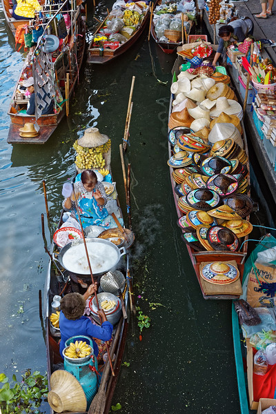 As you see, foodstuffs are not the only wares for sale at the Damnoen Saduak floating market.
