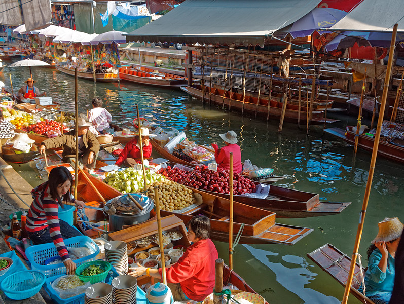 A cornucopia of both fresh and prepared fruits is available at the floating market at Damnoen Saduak, near Bangkok. Here are rose apples, Thai guava, sapodilla, and other fruits.