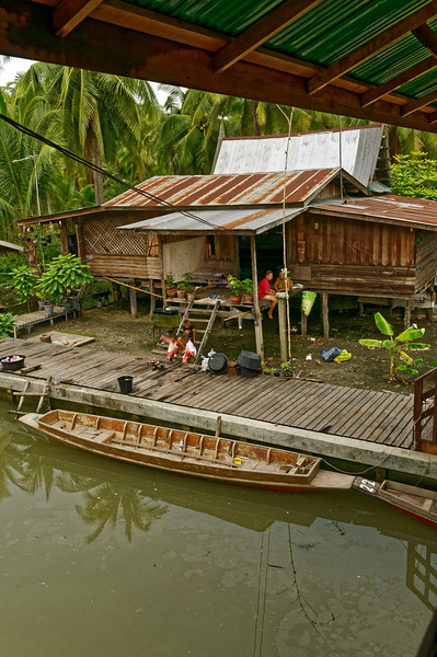 A dwelling along the principal canal at Tha Kha