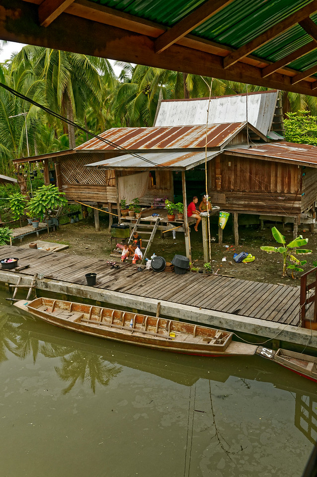 A dwelling along the principal canal at Tha Kha
