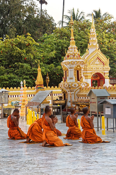 Monks offering a reverential <i>wai</i> to the temple's venerable stupa, believed to contain a breastbone of the Buddha, at Wat Phra That Phanom, Nakhon Phanom, northeast Thailand