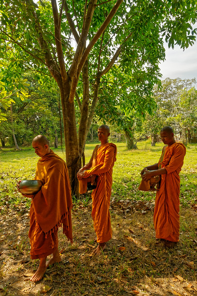 In Sisaket, northeast Thailand, monks with their bowls used to receive food or other offerings, following a tradition dating back to the Buddha himself