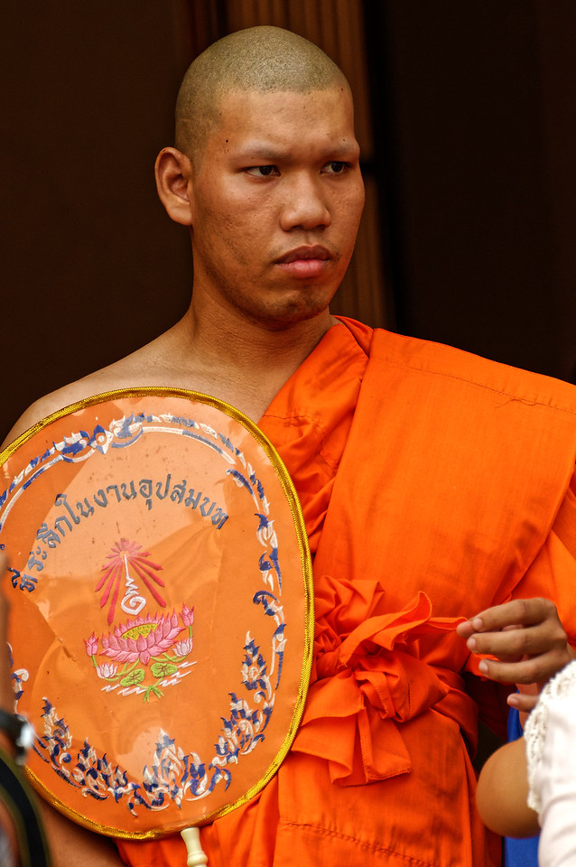 A newly ordained monk emerges from his ordination ceremony at Wat Phra Pathom, in Nakhon Pathom, west of Bangkok.