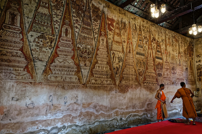 Monks in the ordination hall at Wat Ko Keo Suttharam, Petchaburi. The temple's extraordinary murals, depicting episodes from the life of the Buddha, date from 1734.