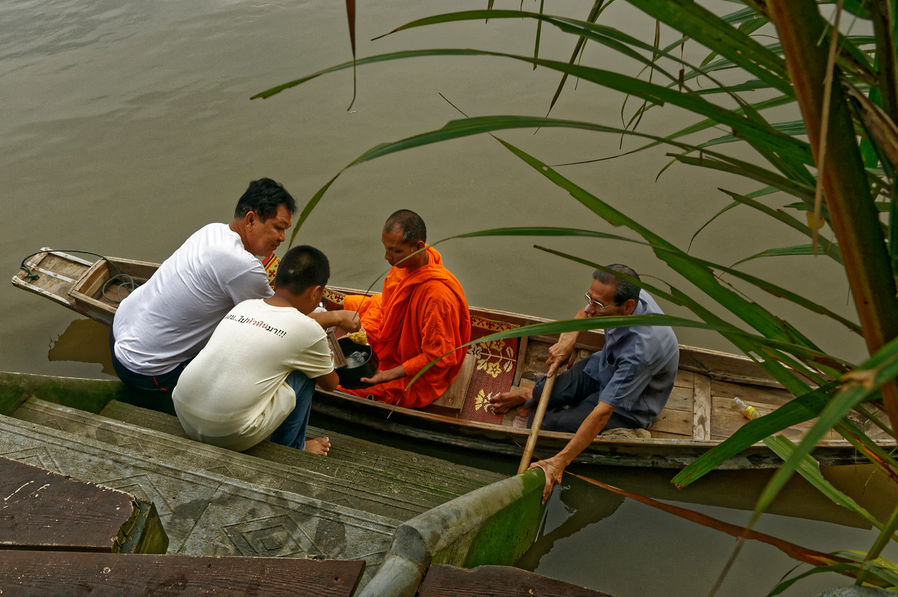 Reminiscent of an earlier era when rivers and canals were primary travel routes in Thailand, some monks at Samut Songkram, on the Mae Klong river near Bangkok, make their morning rounds by boat, stopping at landings to allow the faithful to make merit with their offerings.