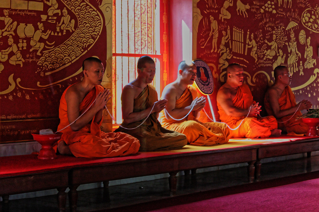Monks chanting verses from the scriptures. Wat Chiang Man, Chiang Mai