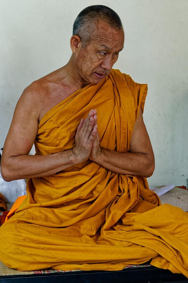 Blind monk offering a benediction at Wat Thapo, Rasi Salai, Sisaket Province