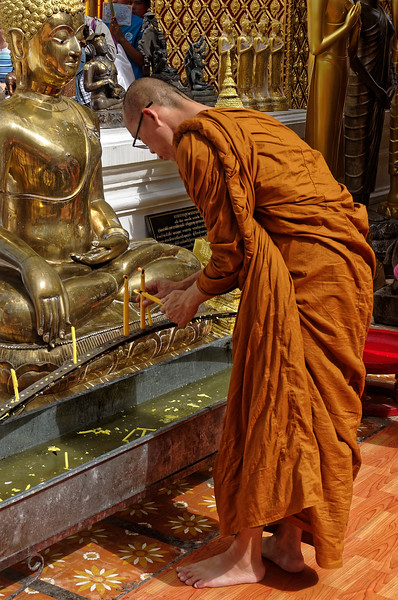 Monk making merit at Wat Phra Boromathat Doi Suthep, Chiang Mai