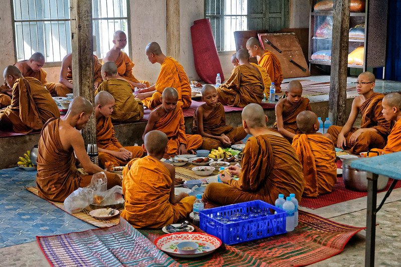 Young novices having their breakfast at Wat Luang, Sisaket