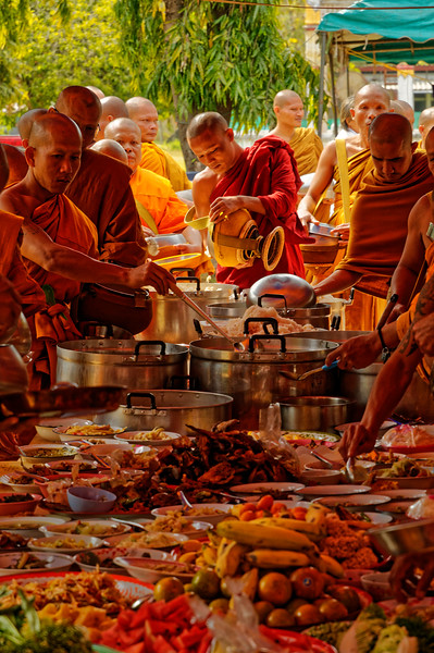 At this gathering of monks from a number of temples in the Sisaket area, people brought an abundant variety of dishes to eat—a way of making merit. Wat Leab, Sisaket