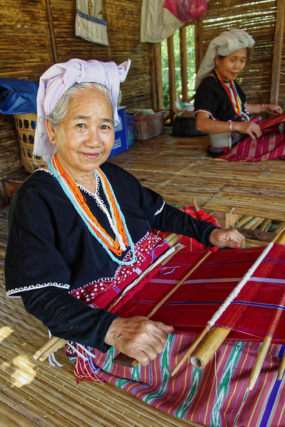 There are two major groups within the Karen hill tribe: the Skaw (or Sgaw) and the Por (or Pwo). Karen women have a well-deserved reputation as highly accomplished and skillful weavers. Here, two Skaw women work on backstrap looms, the traditional method of weaving used by the Karen.