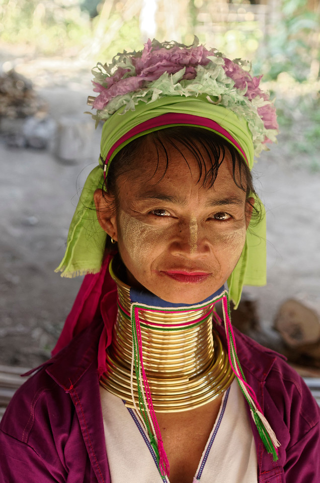 "The so-called ""longneck"" women belong to the Paduang subgroup of the Karen hill tribe. Both the origin and purpose of the brass neck coils are obscure. Many now consider the practice to be grossly exploitative, perpetuated for commercial purposes only. Some Paduang girls and women have stopped wearing the coils. Others seem to see them as emblems of both cultural identity and beauty, though some of the girls would clearly seem to be too young to be making such decisions (as can be seen in the Young Folks 2 gallery)."