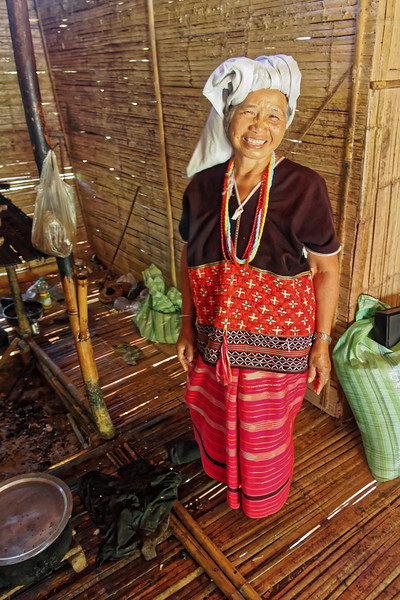 This Karen woman in beautifully patterned and colorful traditional woven tunic and skirt greeted me at her home with this lovely smile and warm welcome. Karen houses, like those of other hill tribes, are rudimentary structures made from bamboo, with thatched roofs. Unlike those of some other groups, such as the Hmong, their houses are raised above the ground on stilts.