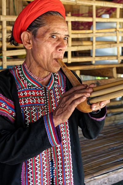 Yellow Lahu gent with musical instrument