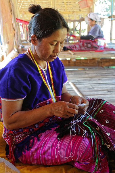 Karen Skaw woman embroidering a piece of clothing