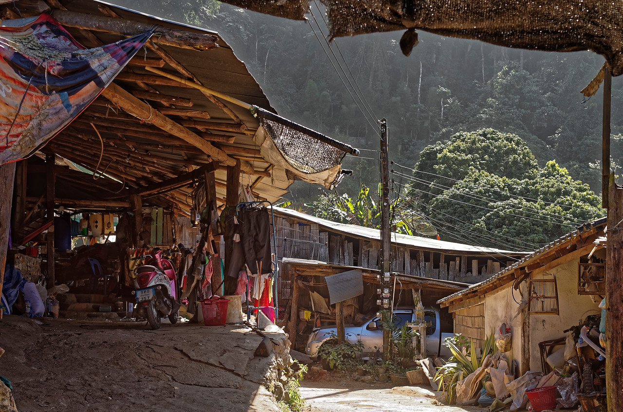 Glimpse of a garage and dwellings at Doi Pui