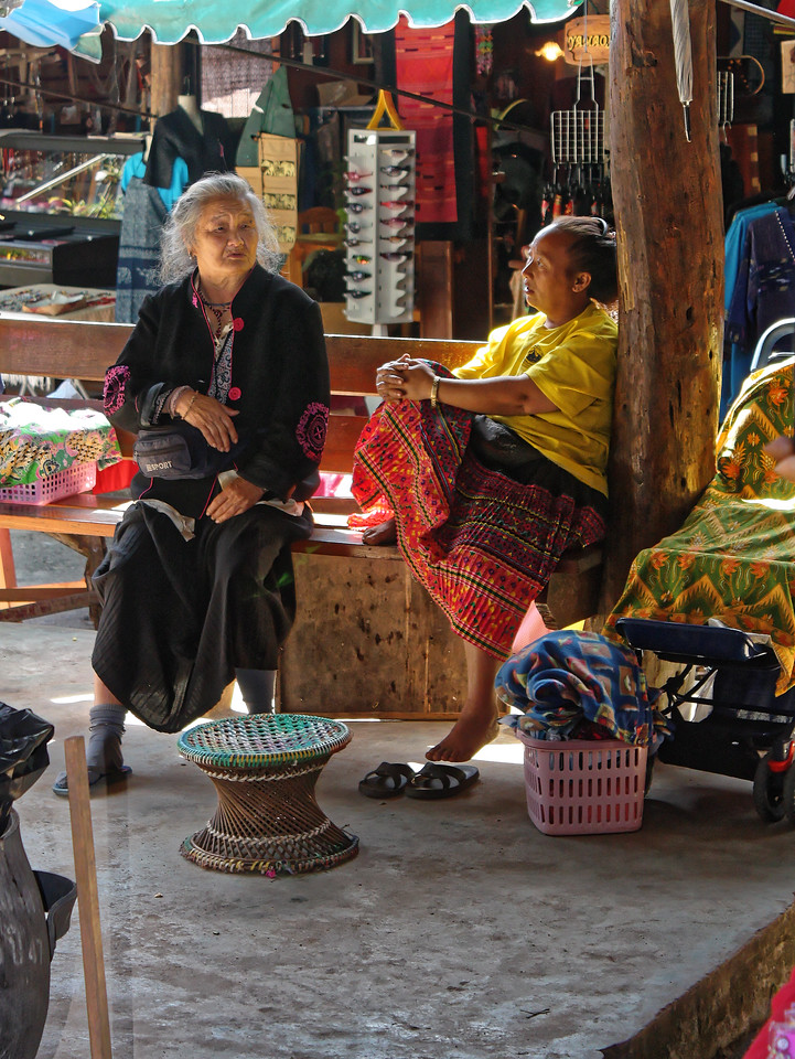 Hmong women in contemplative conversation at Doi Pui