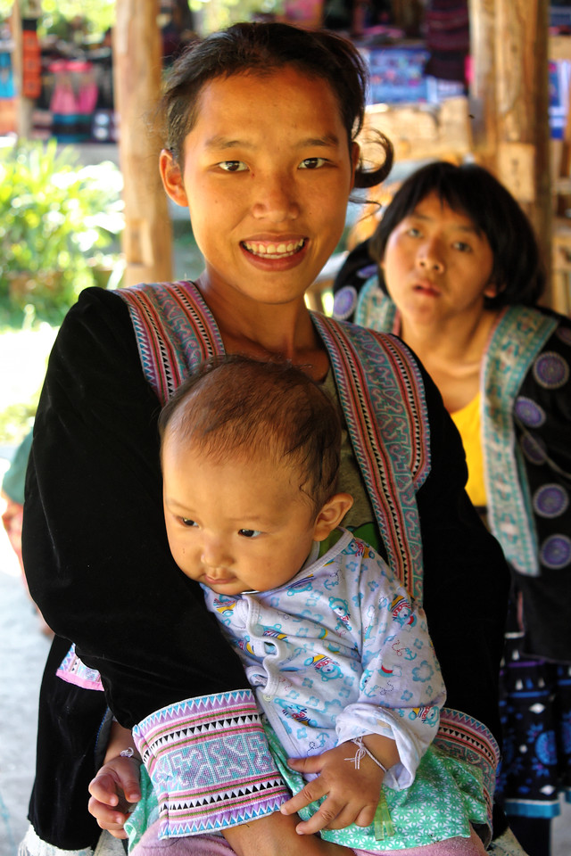 A proud Hmong mother with her child