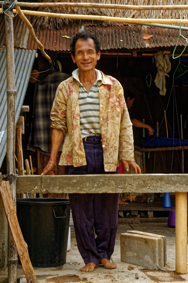 This friendly gent came out to greet me when he saw me passing by on the street in front of his home at Ban La Up, clearly pleased to have me take his picture.