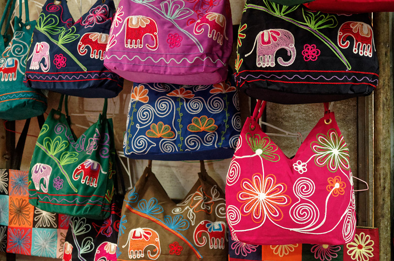 Vibrant colors and bold graphics on these Hmong handbags for sale at Doi Pui