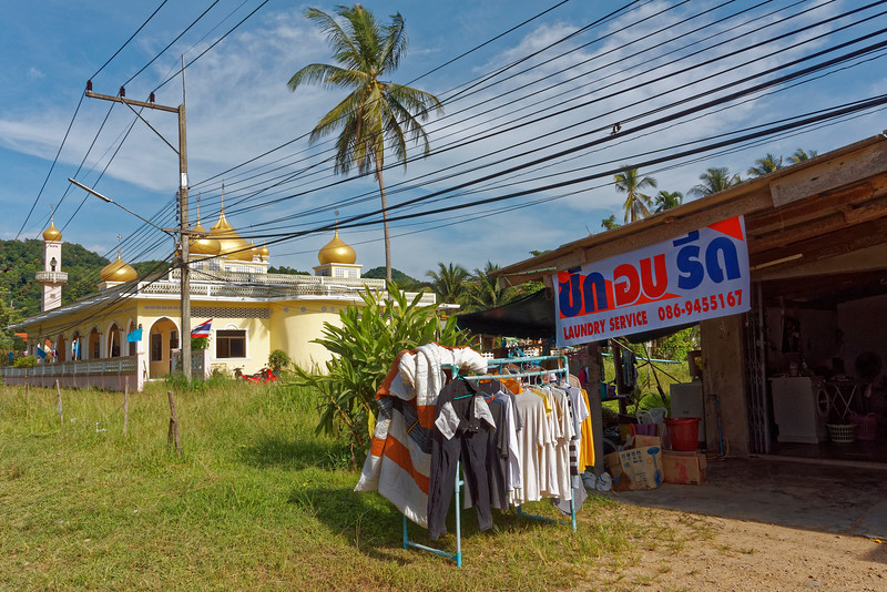 Muslim mosque meets laundry service and the ubiquitous overhead wires. Ao Nang, southern Thailand