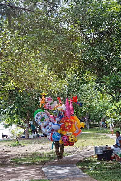 A walking conglomeration of beach balls and related paraphernalia. Ao Nang, southern Thailand