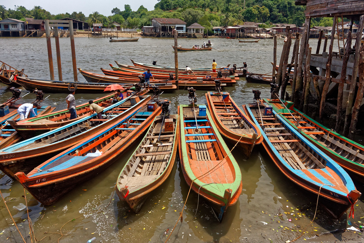 Longtail boats at Ranong's Saphan Pla port, southern Thailand. The boats are used to ferry passengers across the Pak Chan Estuary to the Burmese town of Victoria Point and to a nearby island that features a gambling casino/resort and an 18-hole golf course.