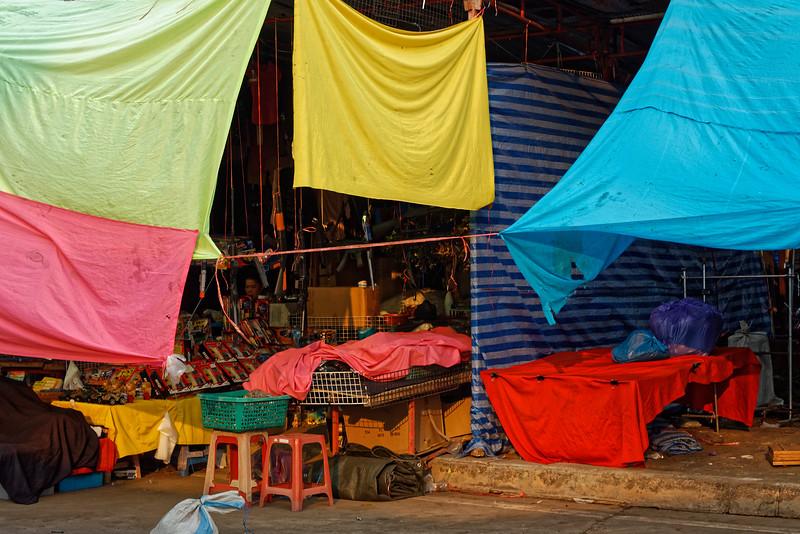 Improvised sun blockers at a street market, Nakhon Phanom, northeast Thailand