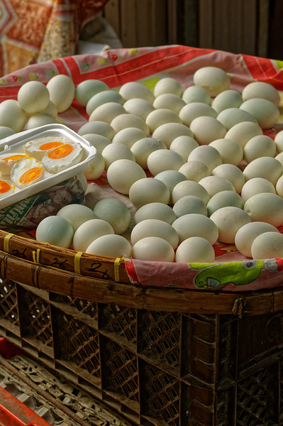 Duck eggs, which would have been soaked in brine for two or three weeks before being boiled. Don Wai Market