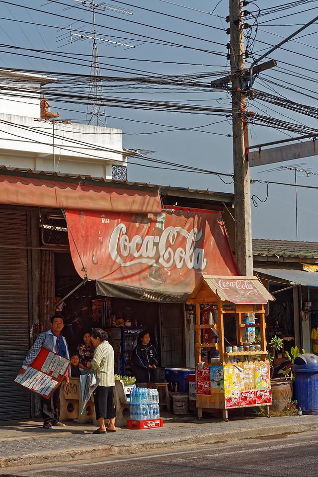 Lottery-ticket seller outside a convenience store, Damnoen Saduak