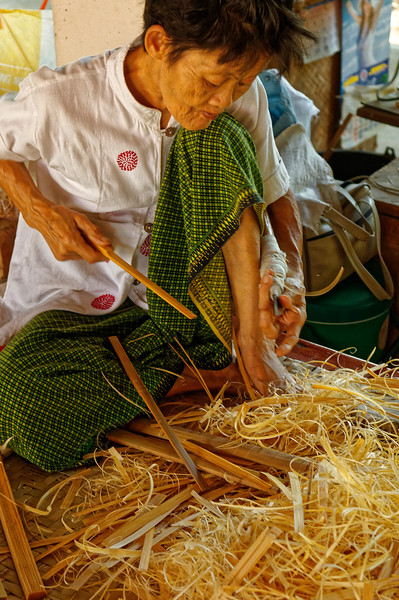 At Bo Sang, umbrella-making is a group effort that involves cutting the bamboo for the ribs and struts used for the scaffolding, shaving it down, drilling holes, and stitching the component parts together.