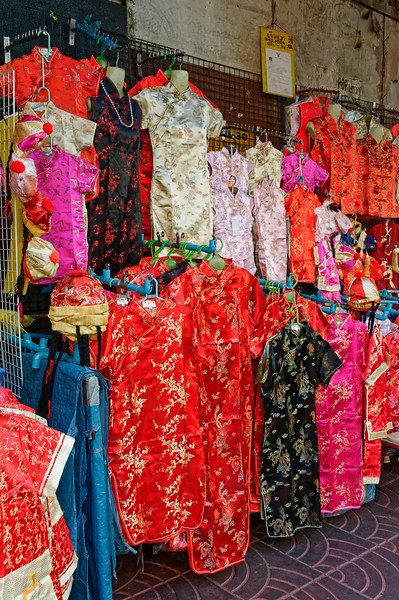 Low-overhead retailing, with dresses lining the sidewalk