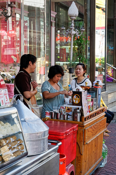 Coffee, cocoa, and tea from a stand displaying an image of the king, Rama IX