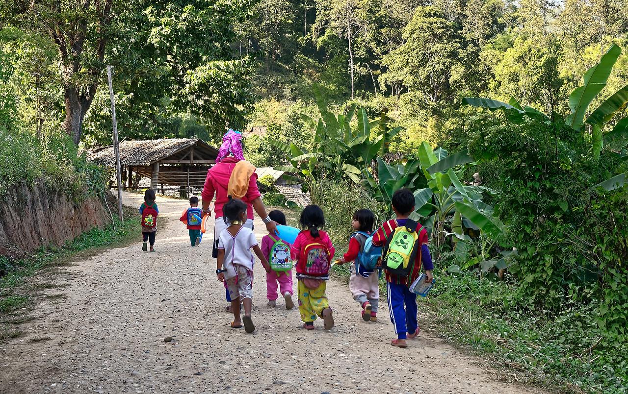 Karen children on their way home from school