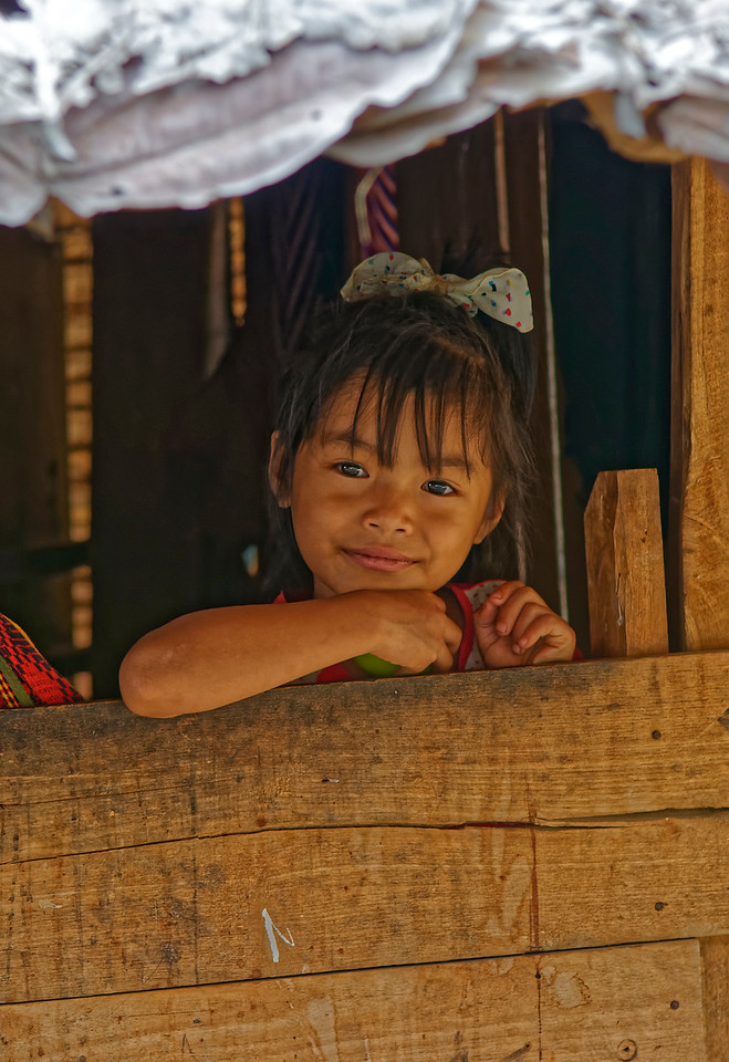 Karen girl looking out from her house at Ban Kariang, Mae Sa Kua, Mae Hong Son Province