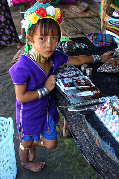 Another little Paduang girl, wearing neck coils as well as other coils on her wrists and legs, Mae Sa Valley