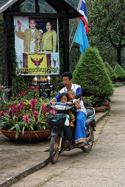 Hill tribe father and children at the Royal Agriculture Station Inthanon, northern Thailand. In Thailand, it is not the least unusual to see families of 3, 4, or even 5 together on a motorbike.