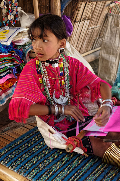 Karen girl working with a backstrap loom, Mae Sa Valley