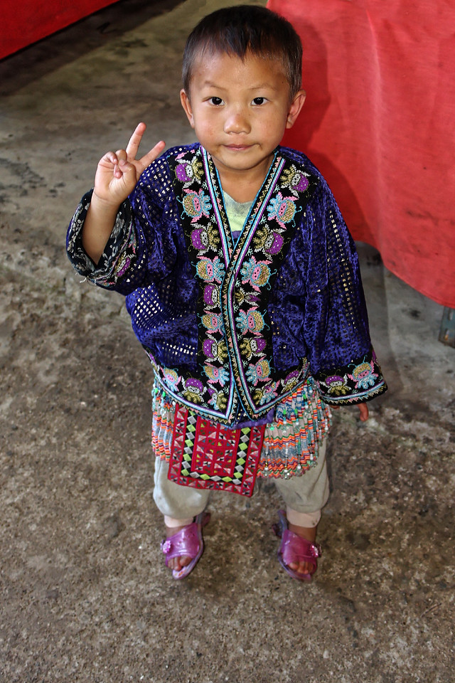 A little Hmong boy greets a visitor to his village at Doi Pui, near Chiang Mai