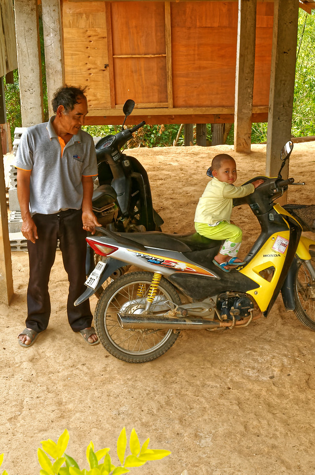 Checking out a motorbike in the Lawa village of Ban La Up, near Mae Hong Son, northern Thailand