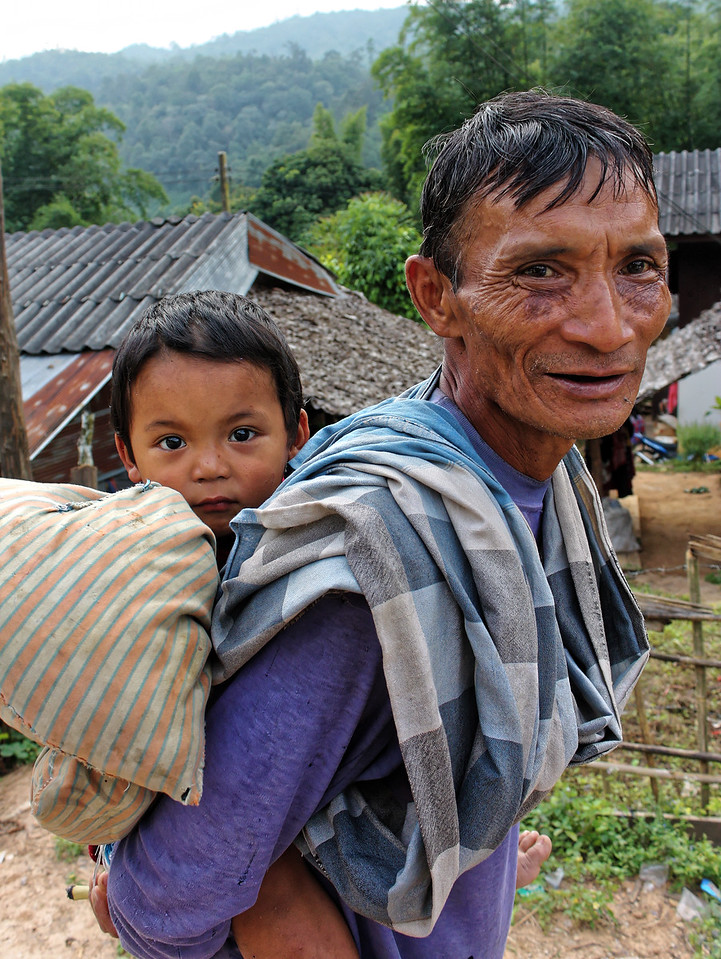 Grandfather and grandson at a Karen village in the north of Thailand